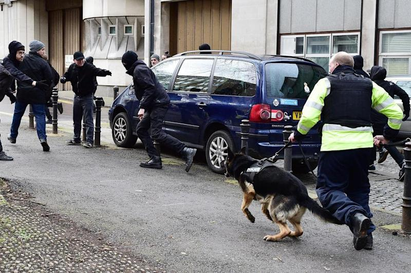 Police dogs: Dog units were called in to contain protesters (PA)