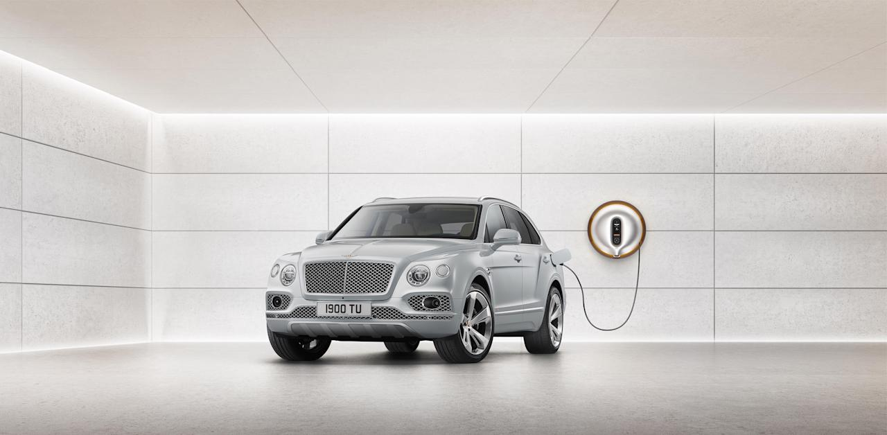 """This plug-in hybrid version of Bentley's super-SUV doesn't exactly qualify as """"green,"""" but it does allow 30 miles of pure electric range and reduced emissions. It also comes with an in-home fast-charging station designed by Phillipe Starck."""