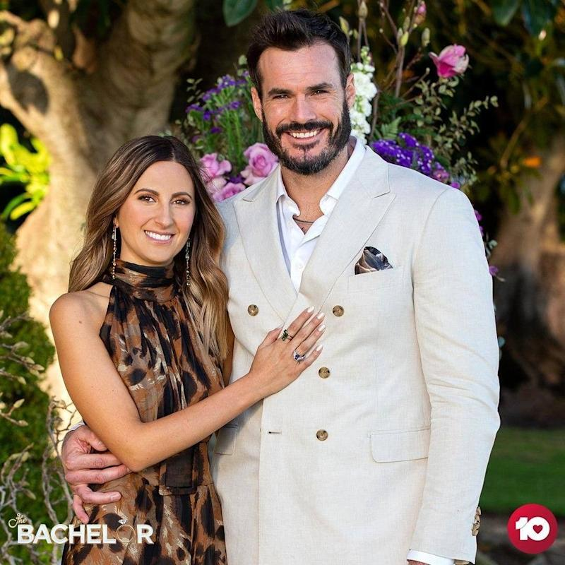 Irena Srbinovska wearing a brown animal print gown and Locky Gilbert wearing a cream suit in The Bachelor 2020 Australia finale