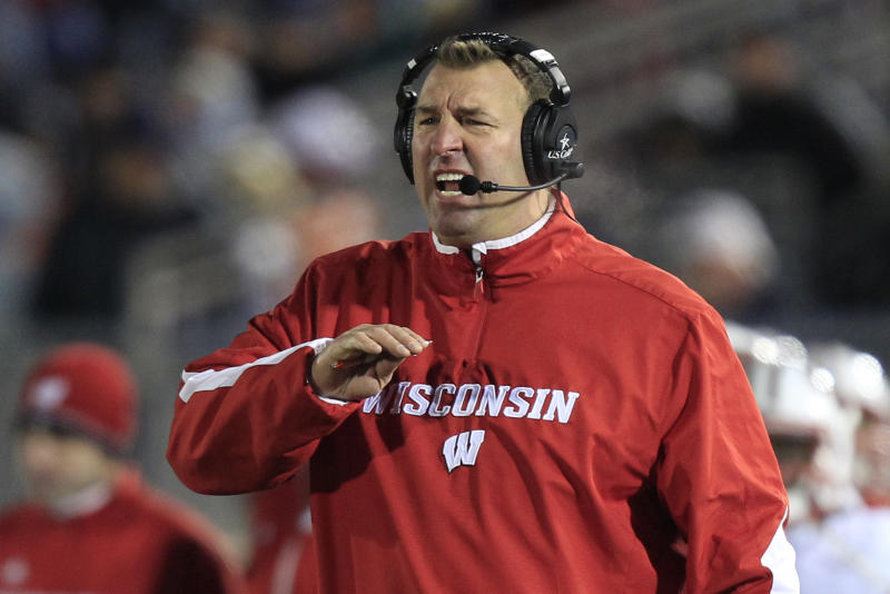 FILE - In this Nov. 24, 2012, file photo, Wisconsin head coach Bret Bielema shouts from the sidelines during an NCAA college football game against Penn State in State College, Pa. . A person familiar with the situation tells The Associated Press on Tuesday, Dec. 4, 2012, that Bielema has agreed to become the new coach at Arkansas. (AP Photo/Gene J. Puskar, File)