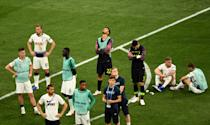 Tottenham Hotspur look dejected following the UEFA Champions League final defeat (Photo by Joe Giddens/PA Images via Getty Images)