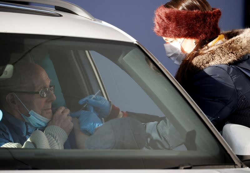 A man receives the Pfizer-BioNTech COVID-19 vaccine at a drive through vaccination centre amid the outbreak of the coronavirus disease (COVID-19) in Hyde, Britain