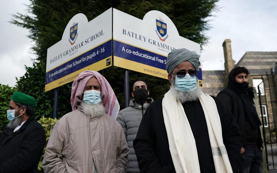 People gather outside the gates of Batley Grammar School, after a teacher was suspended for showing an image of the Prophet Muhammad in class, on March 26 - Christopher Furlong/Getty Images Europe
