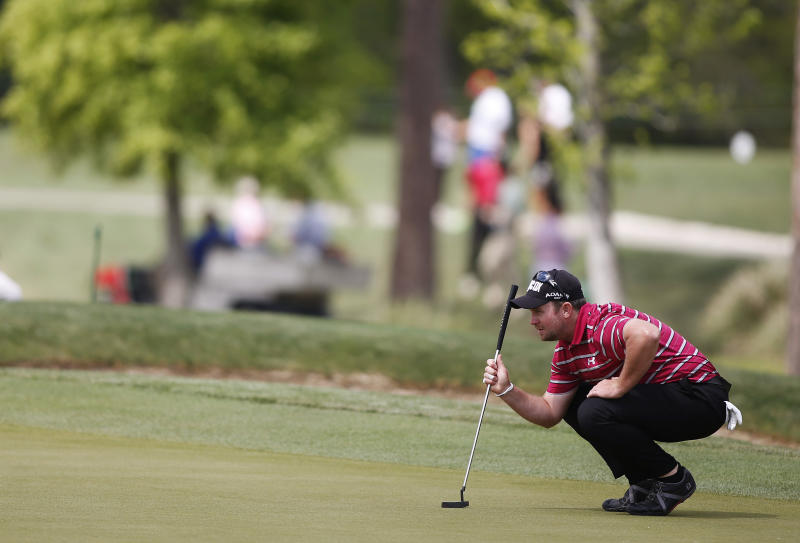 Steve Wheatcroft sets up his putt on the second green during the second round of the Houston Open golf tournament, Friday, March 29, 2013, in Humble, Texas. (AP Photo/Jon Eilts)