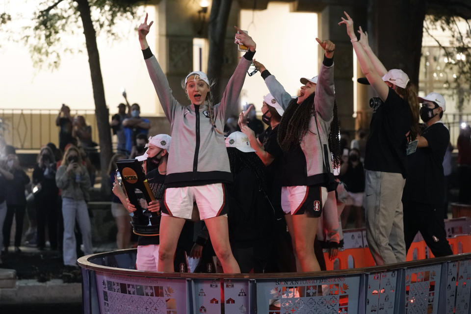 Stanford players celebrate on the River Walk after defeating Arizona 54-53 in the championship game of the women's Final Four NCAA college basketball tournament, Sunday, April 4, 2021, at the Alamodome in San Antonio. (AP Photo/Morry Gash)