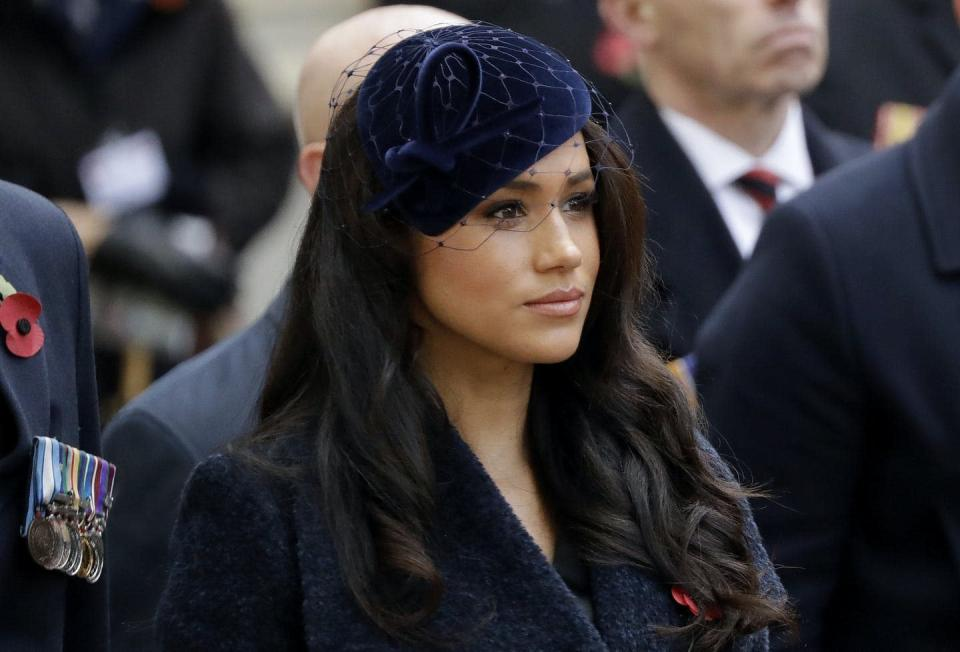"""<span class=""""caption"""">In this November 2019 photo, Meghan, the Duchess of Sussex, stands beside her husband at a Remembrance Day ceremony. She's among high-profile women to go public with her miscarriage. </span> <span class=""""attribution""""><span class=""""source"""">(AP Photo/Matt Dunham)</span></span>"""