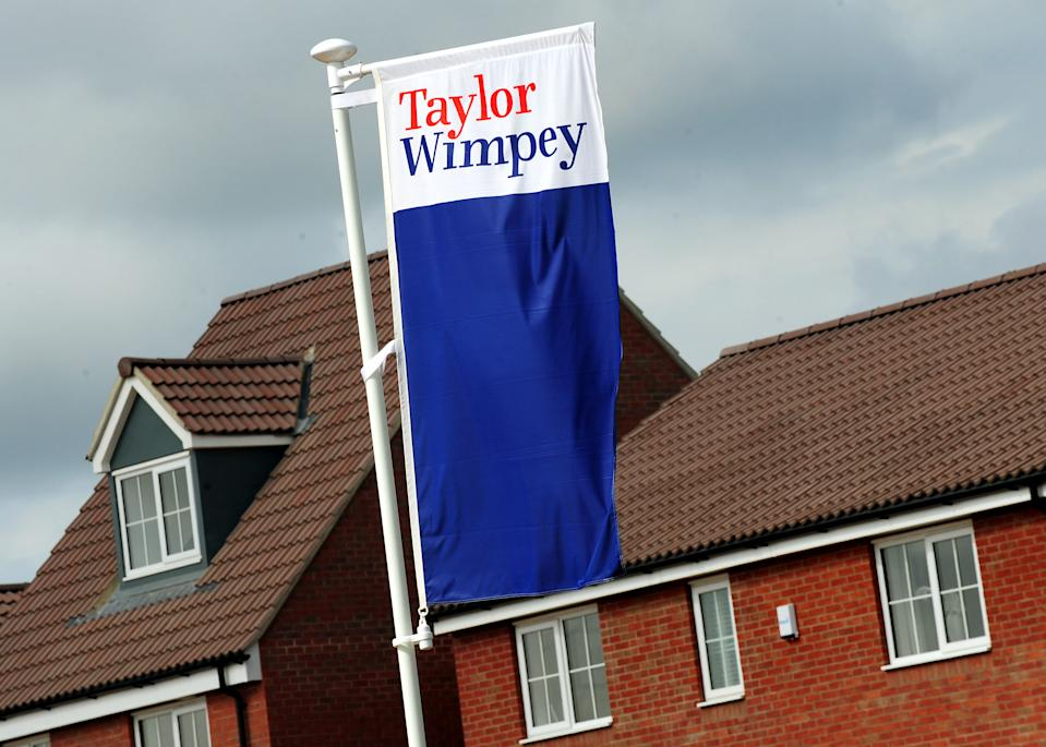 General view of Taylor Wimpey signs at a housing development in Calverton, Nottinghamshire.