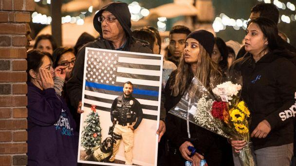 PHOTO: Family members of police Cpl. Ronil Singh including Birend Singh, holding picture at left, attend a candlelight vigil for the slain officer in downtown Newman, Calif., Dec. 28, 2018. (Andy Alfaro/The Modesto Bee via AP)