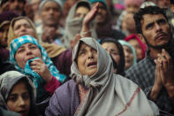 Kashmiri Muslim devotees offer prayer outside the shrine of Sufi saint Sheikh Syed Abdul Qadir Jeelani in Srinagar, Indian controlled Kashmir, Dec. 9, 2019. Hundreds of devotees gathered at the shrine for the 11-day festival that marks the death anniversary of the Sufi saint. The image was part of a series of photographs by Associated Press photographers which won the 2020 Pulitzer Prize for Feature Photography. (AP Photo/Mukhtar Khan)