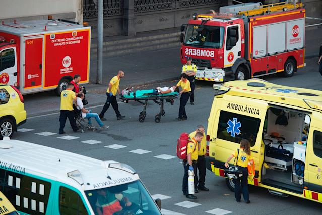 <p>A victim is stretchered towards emergency vehicles parked outfront of the Estacio de Franca (Franca station) in central Barcelona on July 28, 2017 after a regional train appears to have hit the end of the track inside the station injuring dozens of people. (Photo: Josep Lagos/AFP/Getty Images) </p>