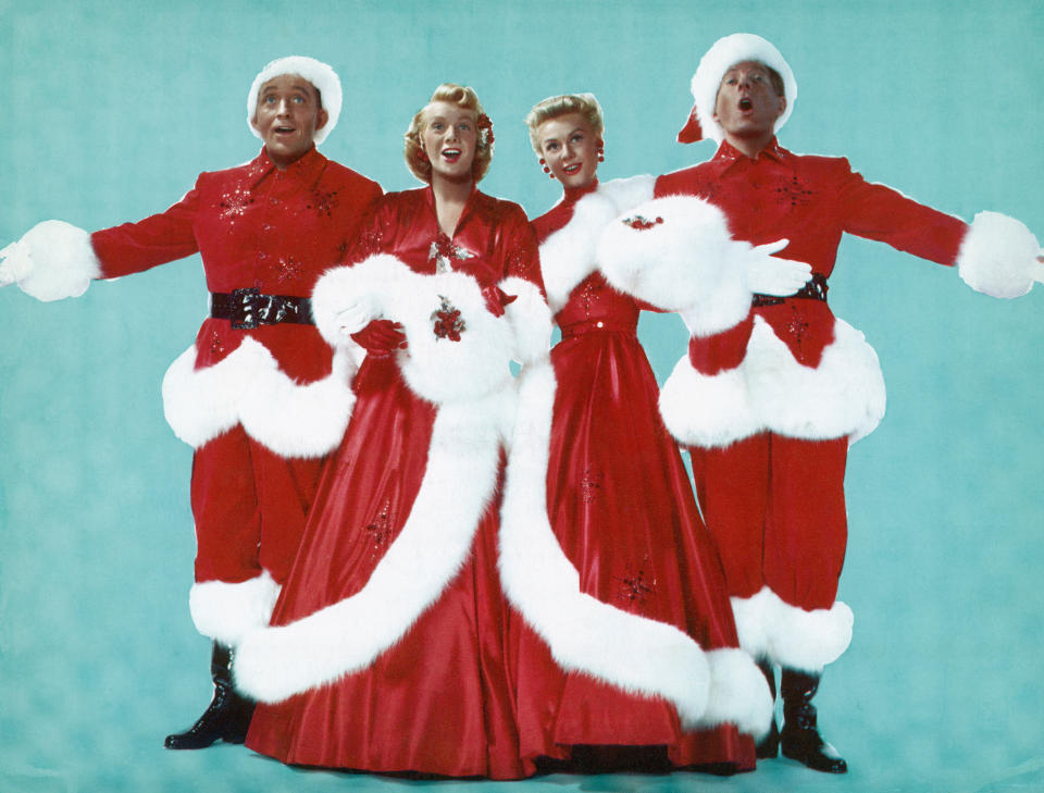 (Original Caption) Left to right are; Actor Bing Crosby, Actresses Rosemary Clooney and Vera Ellen, and Actor Danny Kaye, dressed in Christmas colors as they sing during the 1954 Paramount production of 'White Christmas.' Undated movie still. (Photo by George Rinhart/Corbis via Getty Images)