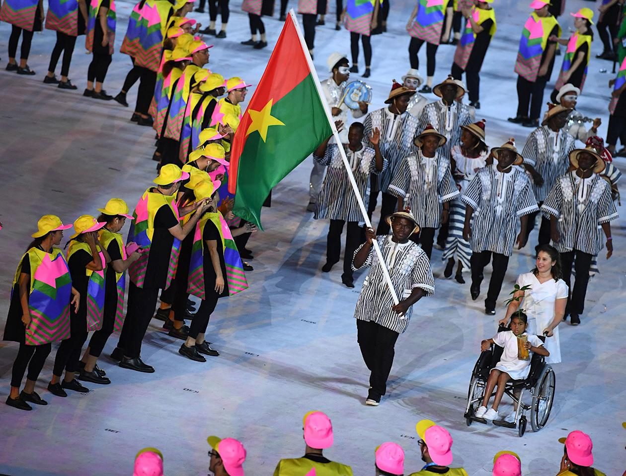 <p>Hands down, this might be the best Opening Ceremony outfit of the night. It ticked not one, not two, but <i>three</i> of fashion's favorite tropes: the stripes, the tunic shape, and the street style-worthy hat. And as a bonus, intricate prints and detailing.</p><p><i>(Photo: Getty Images)</i><br /></p>