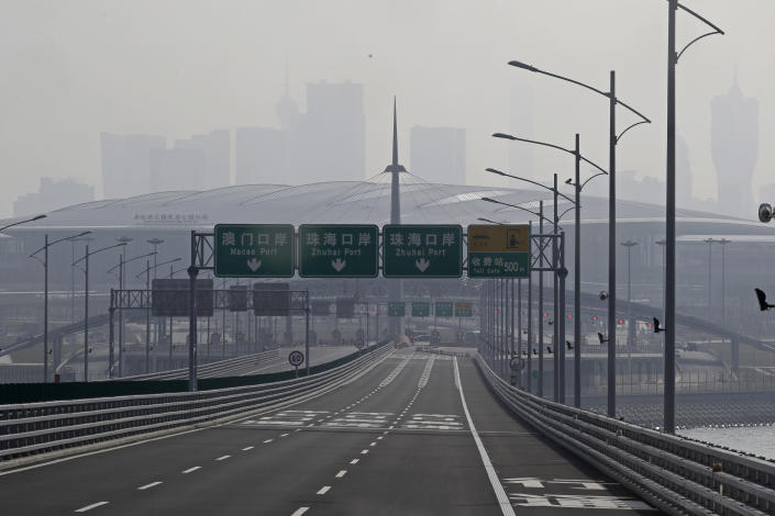 <p>The bridge, the sixth longest on earth, is opening nine years after building first began. (AP Photo/Kin Cheung) </p>