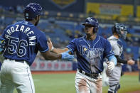 Tampa Bay Rays' Wander Franco celebrates with Randy Arozarena (56) after scoring on an RBI double by Brandon Lowe off New York Yankees pitcher Nestor Cortes during the fourth inning of a baseball game Wednesday, July 28, 2021, in St. Petersburg, Fla. (AP Photo/Chris O'Meara)