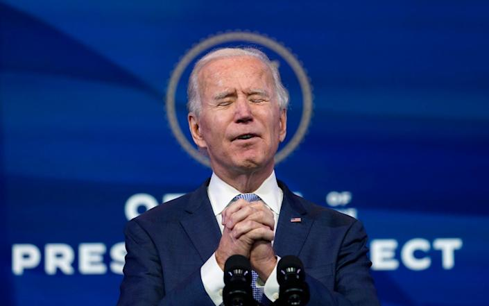 Biden wants to allow more people to have the first dose of Covid-19 vaccines - AP