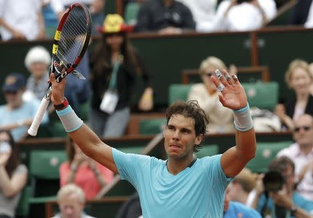 Rafael Nadal of Spain reacts after winning his men's singles match against Dusan Lajovic of Serbia at the French Open tennis tournament at the Roland Garros stadium in Paris
