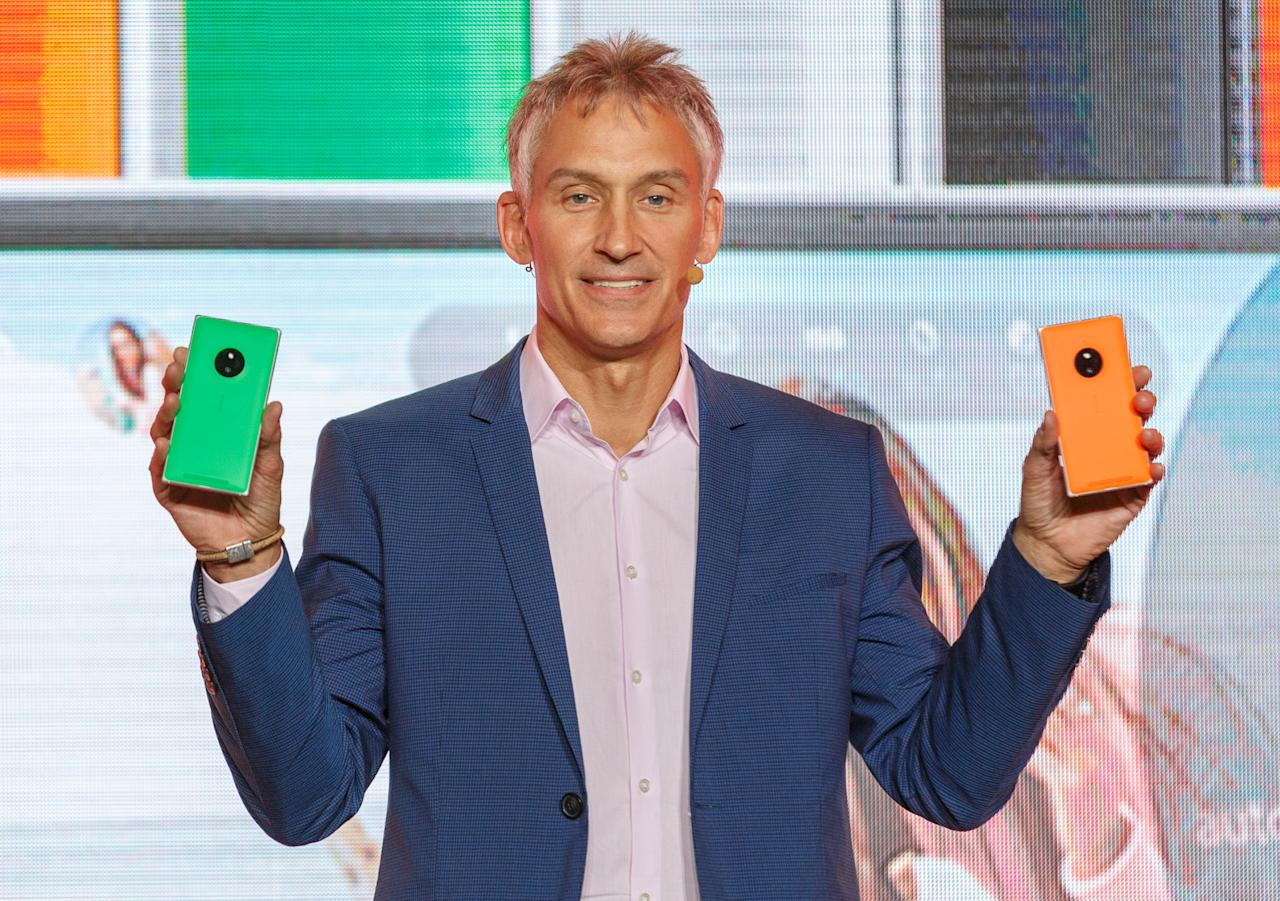 Chris Weber, Microsoft's corporate vice president of mobile devices sales, shows off the Nokia Lumia 830 during the IFA trade show.
