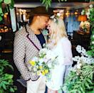 """<p>After 20 years together, Emma Bunton<a href=""""https://www.elle.com/uk/fashion/celebrity-style/g36966719/spice-girls-outfits/"""" rel=""""nofollow noopener"""" target=""""_blank"""" data-ylk=""""slk:aka Baby Spice"""" class=""""link rapid-noclick-resp""""> aka Baby Spice </a>married her longtime partner Damages singer Jade Jones in a small ceremony. For the occasion, the bride <a href=""""https://go.redirectingat.com?id=127X1599956&url=https%3A%2F%2Fwww.mytheresa.com%2Fen-gb%2Fmiu-miu-silk-blend-mini-dress-1562240.html&sref=https%3A%2F%2Fwww.elle.com%2Fuk%2Ffashion%2Fcelebrity-style%2Fg31805%2Fcelebrity-wedding-dresses%2F"""" rel=""""nofollow noopener"""" target=""""_blank"""" data-ylk=""""slk:wore a Miu Miu silk mini dress"""" class=""""link rapid-noclick-resp"""">wore a Miu Miu silk mini dress</a>, with a long, sheer cape which she accessorised with a floral headband to match her bouquet.</p><p><a href=""""https://www.instagram.com/p/CRRqbVnseVM/"""" rel=""""nofollow noopener"""" target=""""_blank"""" data-ylk=""""slk:See the original post on Instagram"""" class=""""link rapid-noclick-resp"""">See the original post on Instagram</a></p>"""