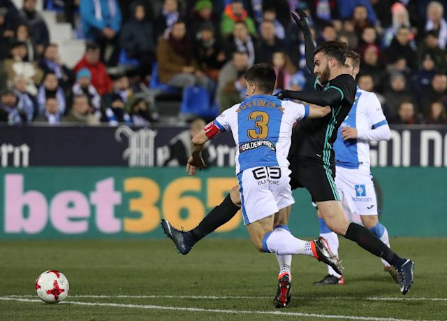 Soccer Football - Spanish King's Cup - Leganes vs Real Madrid - Quarter-Final - First Leg - Butarque Municipal Stadium, Leganes, Spain - January 18, 2018 Real Madrid's Borja Mayoral in action with Leganes' Unai Bustinza REUTERS/Susana Vera