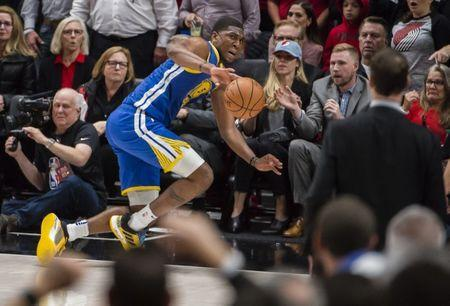 May 20, 2019; Portland, OR, USA; Golden State Warriors center Kevon Looney (5) dives to save the basketball from going out of bound during the second half against the Portland Trail Blazers in game four of the Western conference finals of the 2019 NBA Playoffs at Moda Center. The Warriors won 119-117 in overtime. Mandatory Credit: Troy Wayrynen-USA TODAY Sports