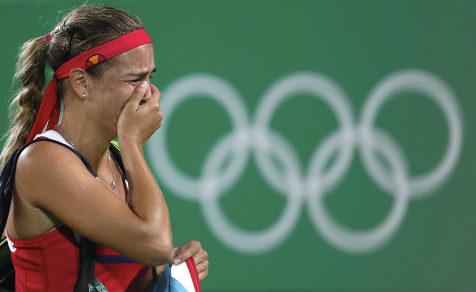 FILE - In this Saturday, Aug. 13, 2016, file photo, Monica Puig, of Puerto Rico, cries after winning the gold medal match in the women's tennis competition at the 2016 Summer Olympics in Rio de Janeiro, Brazil. Reigning Olympic tennis gold medalist Puig will miss the Tokyo Games and the rest of the 2021 season after having surgery on her right shoulder. (AP Photo/Vadim Ghirda, File)