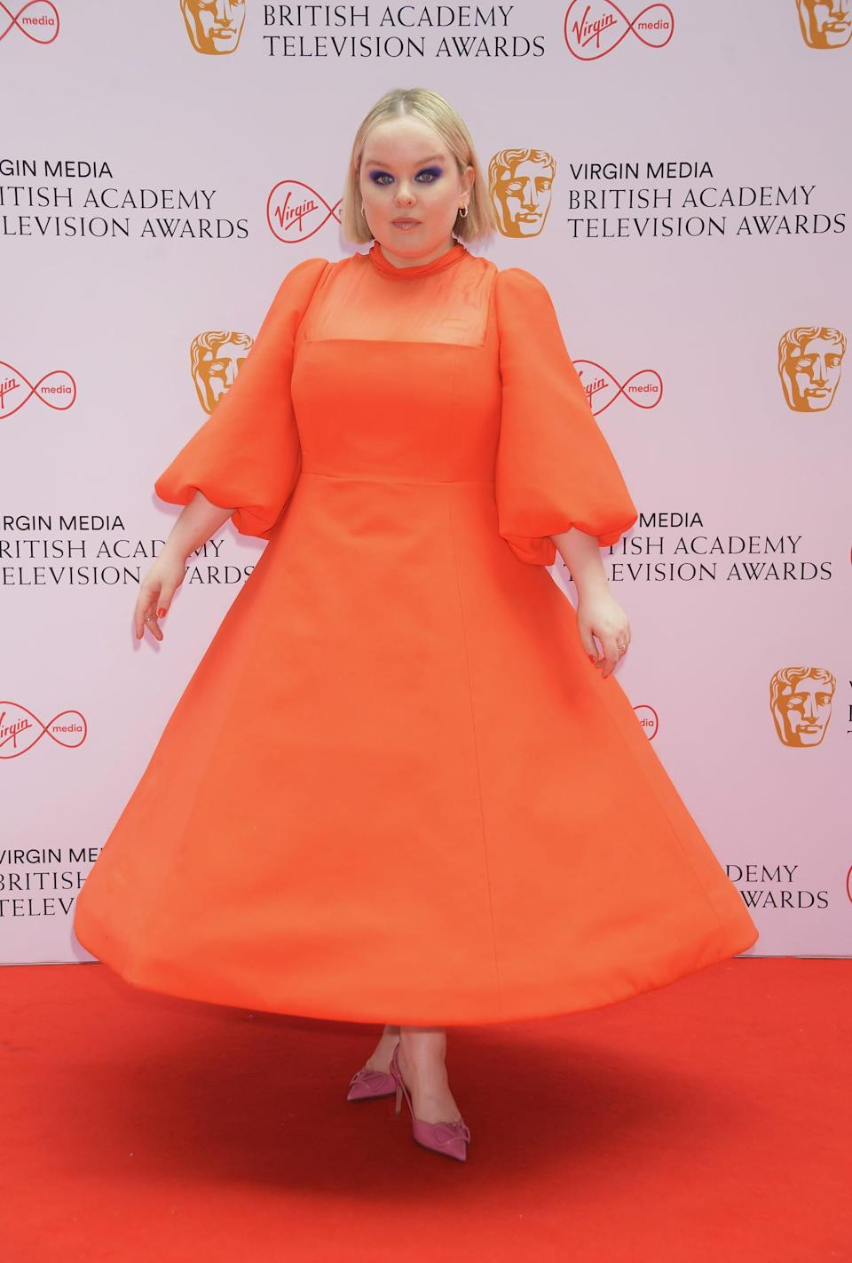 <p>Nicola Coughlan wore a custom orange Valentino dress and rose-pink mules by the brand.</p>