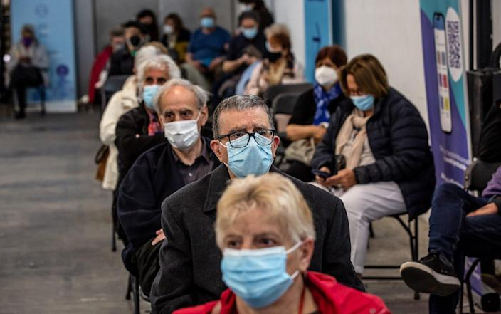 People in a waiting area after they have received a dose of a Covid-19 vaccine at a mass vaccination center inside the Fira de Barcelona exhibition space in Barcelona, Spain - Angel Garcia/Bloomberg