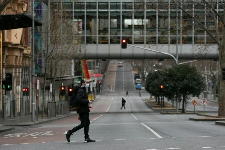 Downtown Melbourne is nearly deserted with the city under lockdown as Victoria state premier Dan Andrews said it was the 'only option' due to the low vaccination rate so far