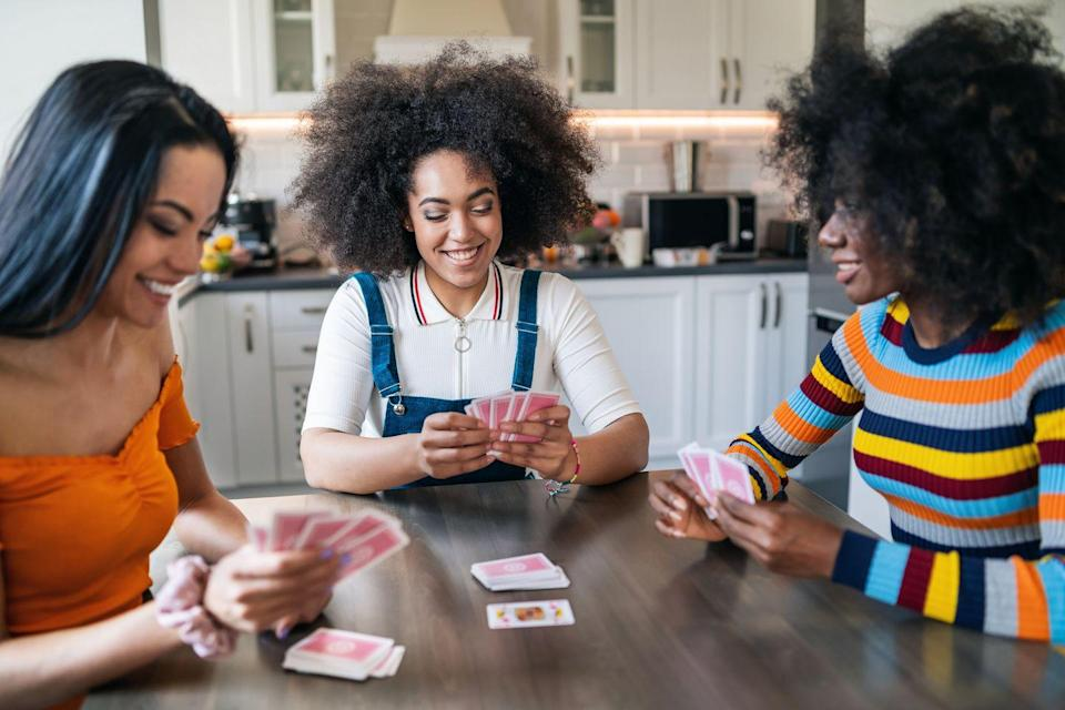 """<p>Need a break from all the sweets and treats? As an alternative, invite a couple of gal pals over for an <a href=""""https://www.oprahmag.com/life/g28436280/games-to-play-with-friends"""" rel=""""nofollow noopener"""" target=""""_blank"""" data-ylk=""""slk:old-fashioned game night"""" class=""""link rapid-noclick-resp"""">old-fashioned game night</a>, featuring modern hits (like Codenames and Cards Against Humanity) as well as a couple of non-PG games, like Telestrations After Dark. If you're <a href=""""https://www.oprahmag.com/life/a32022684/virtual-game-night/"""" rel=""""nofollow noopener"""" target=""""_blank"""" data-ylk=""""slk:celebrating virtually"""" class=""""link rapid-noclick-resp"""">celebrating virtually</a>, there are plenty of fun <a href=""""https://www.oprahmag.com/entertainment/g32057373/best-online-games/"""" rel=""""nofollow noopener"""" target=""""_blank"""" data-ylk=""""slk:games that you can play online"""" class=""""link rapid-noclick-resp"""">games that you can play online</a>, like Werewolf and Ticket to Ride. Either way, encourage your guests to show up in their <a href=""""https://www.oprahmag.com/style/g28857178/best-flannel-pajamas/"""" rel=""""nofollow noopener"""" target=""""_blank"""" data-ylk=""""slk:coziest pajamas"""" class=""""link rapid-noclick-resp"""">coziest pajamas</a> and with <a href=""""https://www.oprahmag.com/life/food/g28099287/fall-cocktails/"""" rel=""""nofollow noopener"""" target=""""_blank"""" data-ylk=""""slk:their favorite cocktail"""" class=""""link rapid-noclick-resp"""">their favorite cocktail</a>—or mocktail in hand.<br></p>"""