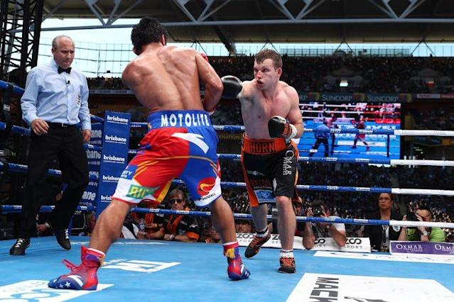 Jeff Horn (R) punches Manny Pacquiao during their bout Saturday for the WBO welterweight title in Brisbane, Australia. (Getty Images)