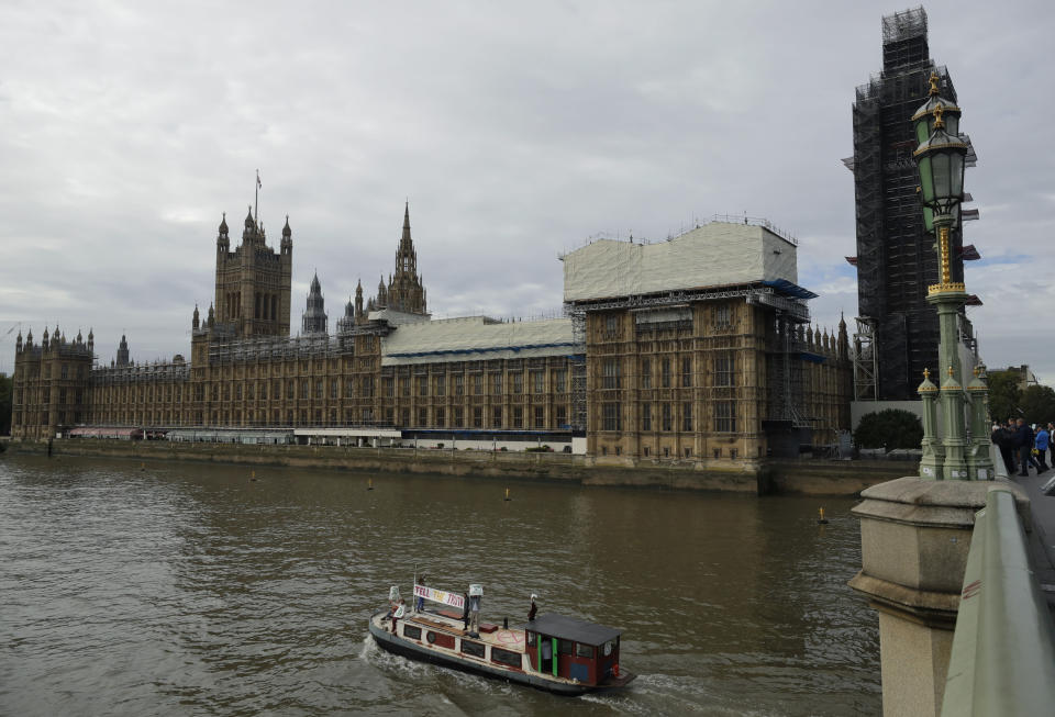"""Climate protestors on a boat with a banner reading """"Tell the Truth"""" passes Britain's Parliament in central London Monday, Oct. 7, 2019. Activists with the Extinction Rebellion movement blocked major roads in London, Berlin and Amsterdam on Monday at the beginning of what was billed as a wide-ranging series of protests demanding new climate policies. (AP Photo/Matt Dunham)"""
