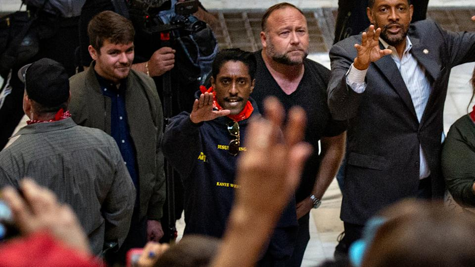 From right - Vernon Jones, Democratic Party member of the Georgia House of Representatives along with and conspiracy theorist Alex Jones and Ali Alexander organizer for Stop the Steal gather at the Georgia Capitol Building  on Wednesday, Nov. 18, 2020 in Atlanta, GA. (Jason Armond/Los Angeles Times via Getty Images)