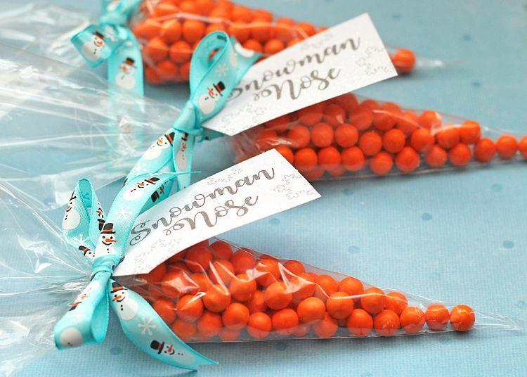 """<p>Invite your friends over for a winter dinner party and pass out these adorable DIY favors on their way out.</p><p><strong>Get the tutorial at <a href=""""https://www.thecraftpatchblog.com/snowman-nose-christmas-gift-idea/"""" rel=""""nofollow noopener"""" target=""""_blank"""" data-ylk=""""slk:The Craft Patch"""" class=""""link rapid-noclick-resp"""">The Craft Patch</a>.</strong></p><p><strong><a class=""""link rapid-noclick-resp"""" href=""""https://www.amazon.com/Ateco-4712-Disposable-Decorating-12-Inch/dp/B01EXHJCTA/?tag=syn-yahoo-20&ascsubtag=%5Bartid%7C10050.g.23489557%5Bsrc%7Cyahoo-us"""" rel=""""nofollow noopener"""" target=""""_blank"""" data-ylk=""""slk:SHOP PIPING BAGS"""">SHOP PIPING BAGS</a><br></strong></p>"""