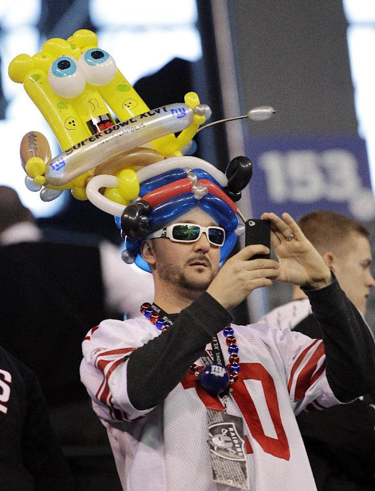 A New York Giants fan takes a photo at Lucas Oil Stadium before the NFL Super Bowl XLVI football game between the New England Patriots and the New York Giants, Sunday, Feb. 5, 2012, in Indianapolis. (AP Photo/David Duprey)