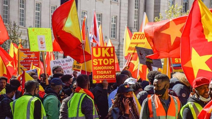 """2021/04/25: Protesters gather while holding Tigray flags during the demonstration. Thousands of people marched through Central London in protest of what the demonstrators call Ethiopia's and Eritrea's """"genocidal war"""" on the region of Tigray."""