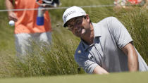 Keegan Bradley chips to the 18th green during the first round of the PGA Championship golf tournament on the Ocean Course Thursday, May 20, 2021, in Kiawah Island, S.C. (AP Photo/Matt York)