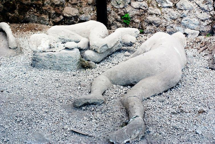 Two plaster casts of victims of the Vesuvius eruption in Pompeii.
