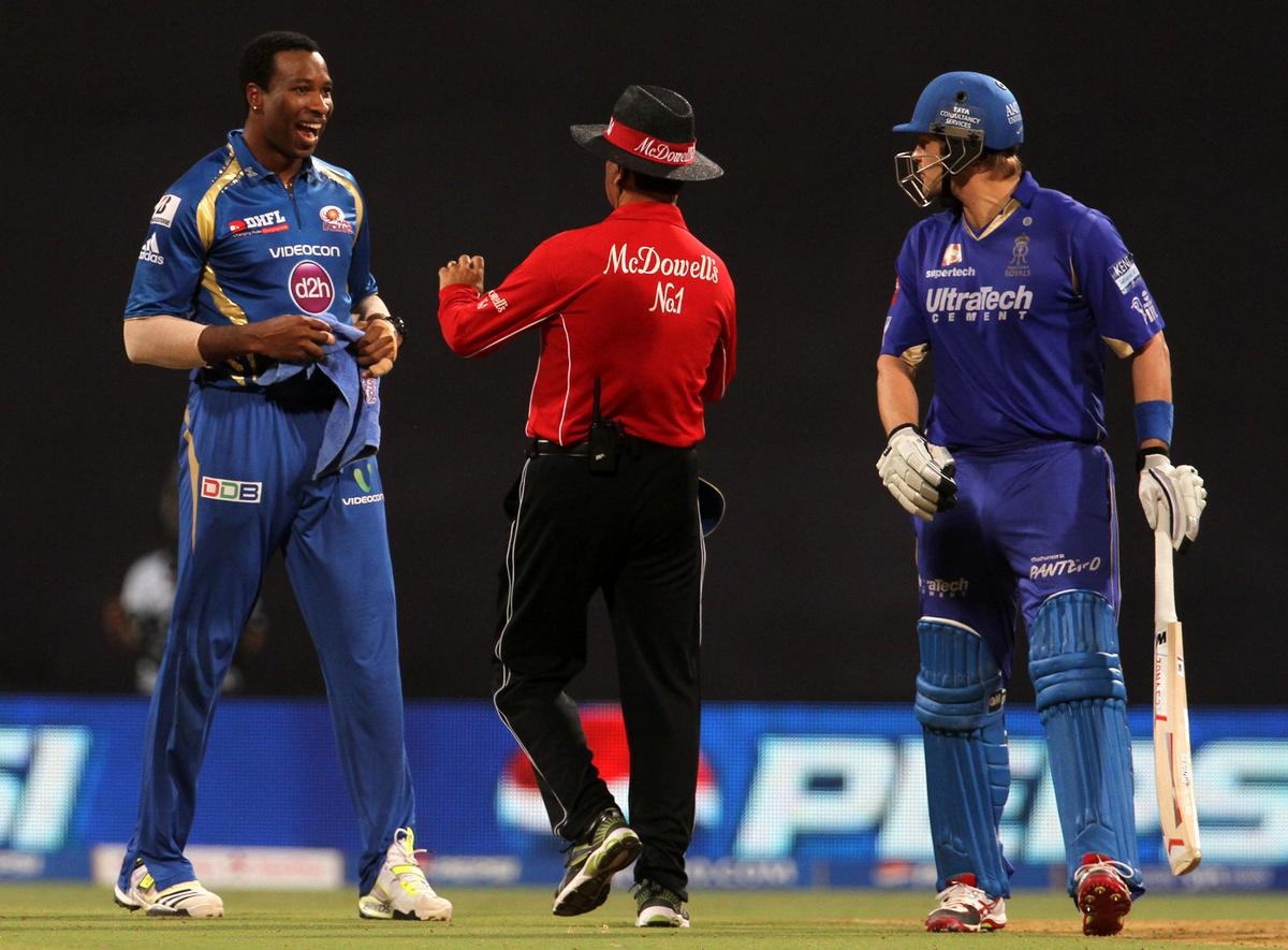 Mumbai Indian player Kieron Pollard and Rajasthan Royals player Shane Watson gets into a argument during match 66 of the Pepsi Indian Premier League ( IPL) 2013  between The Mumbai Indians and the Rajasthan Royals held at the Wankhede Stadium in Mumbai on the 15th May 2013 ..Photo by Vipin Pawar-IPL-SPORTZPICS ..Use of this image is subject to the terms and conditions as outlined by the BCCI. These terms can be found by following this link:..https://ec.yimg.com/ec?url=http%3a%2f%2fwww.sportzpics.co.za%2fimage%2fI0000SoRagM2cIEc&t=1493039535&sig=omairYLJOkppYge1G25.kw--~C