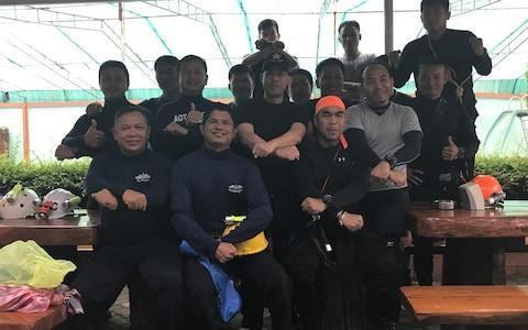 <span>Thai Navy Seals in good spirits at their guest house close to the cave complex</span> <span>Credit: Nicola Smith </span>