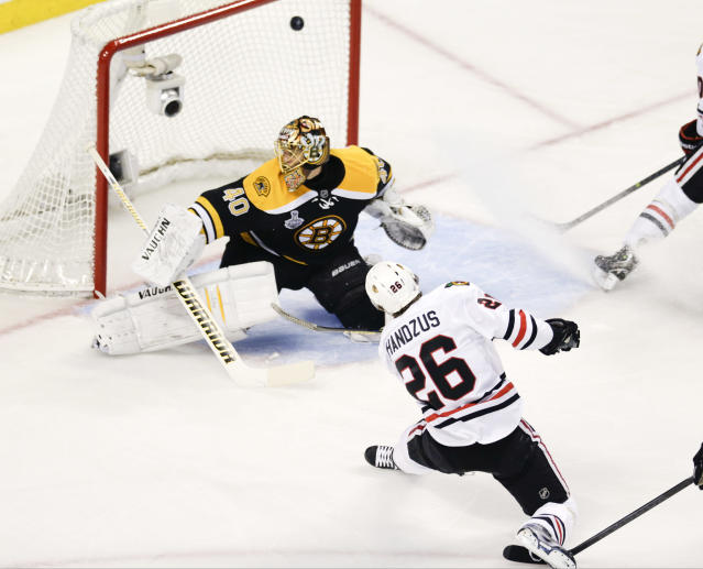 Chicago Blackhawks center Michal Handzus (26), of Slovakia, scores past Boston Bruins goalie Tuukka Rask (40), of Finland, during the first period in Game 4 of the NHL hockey Stanley Cup Finals, Wednesday, June 19, 2013, in Boston. (AP Photo/Charles Krupa)