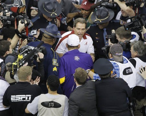 Alabama head coach Nick Sabantalks to LSU head coach Les Miles after the BCS National Championship college football game Monday, Jan. 9, 2012, in New Orleans. Alabama won 21-0. (AP Photo/Bill Haber)