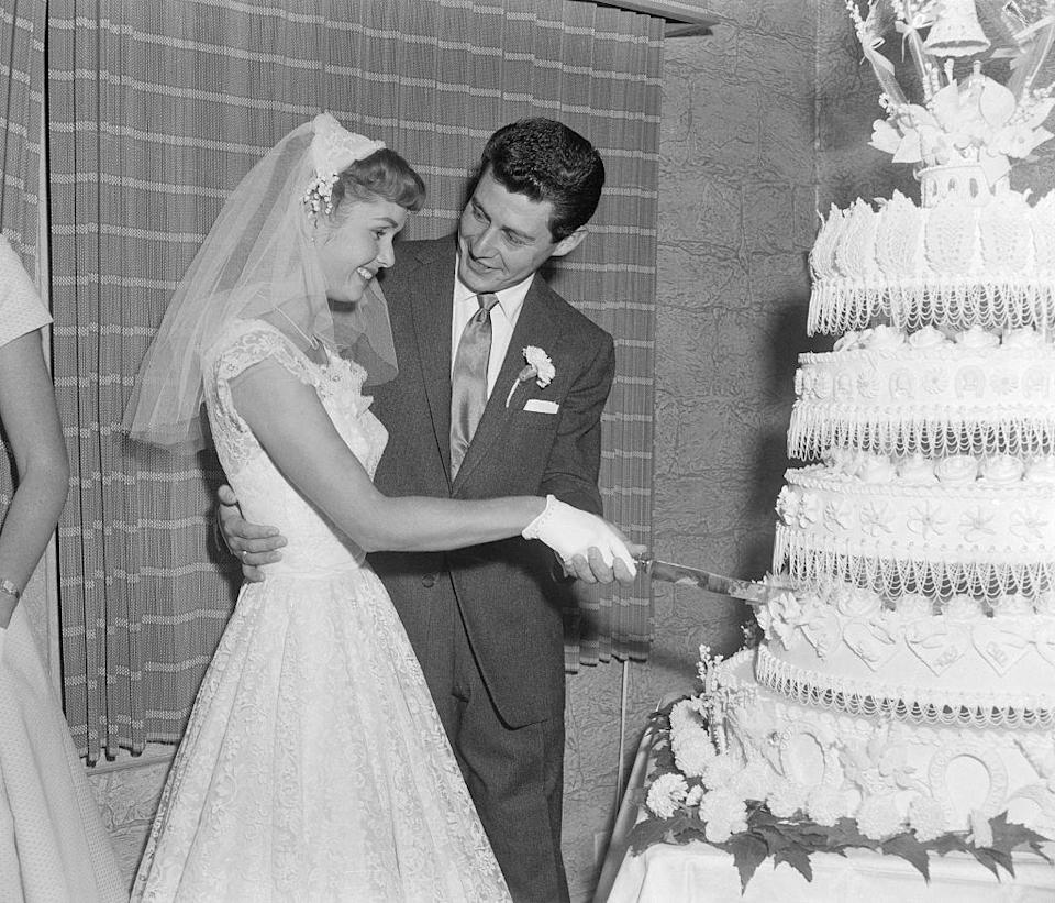 <p>After 15 months of dating, Eddie Fisher and Debbie Reynolds were married at the home of their friend Elaine Grossinger Etess in the Catskills Mountains of New York. </p>