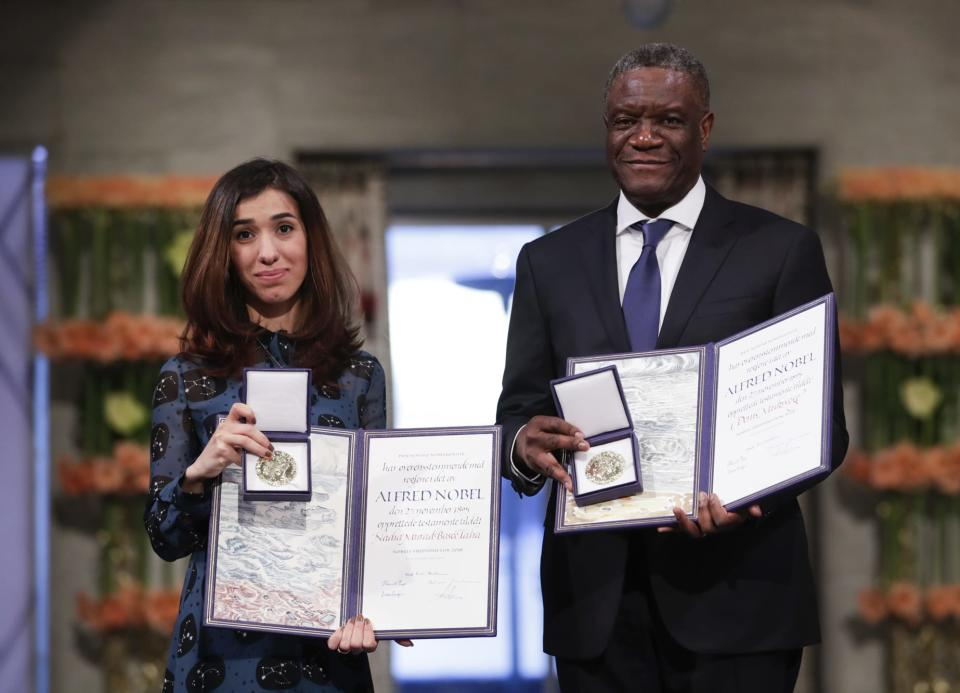 The Peace Prize laureates Dr. Denis Mukwege from Congo and Nadia Murad from Iraq, left, pose with their medals during the Nobel Peace Prize Ceremony in Oslo Town Hall, Oslo, Monday Dec. 10, 2018. Dr. Denis Mukwege and Nadia Murad receive the Nobel Peace Prize recognising their efforts to end the use of sexual violence as a weapon of war and armed conflict. (Haakon Mosvold Larsen / NTB Scanpix via AP, Pool)