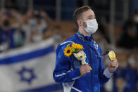 Artem Dolgopyat of Israel, poses after winning the gold medal after the floor exercise during the artistic gymnastics men's apparatus final at the 2020 Summer Olympics, Sunday, Aug. 1, 2021, in Tokyo, Japan. (AP Photo/Ashley Landis)