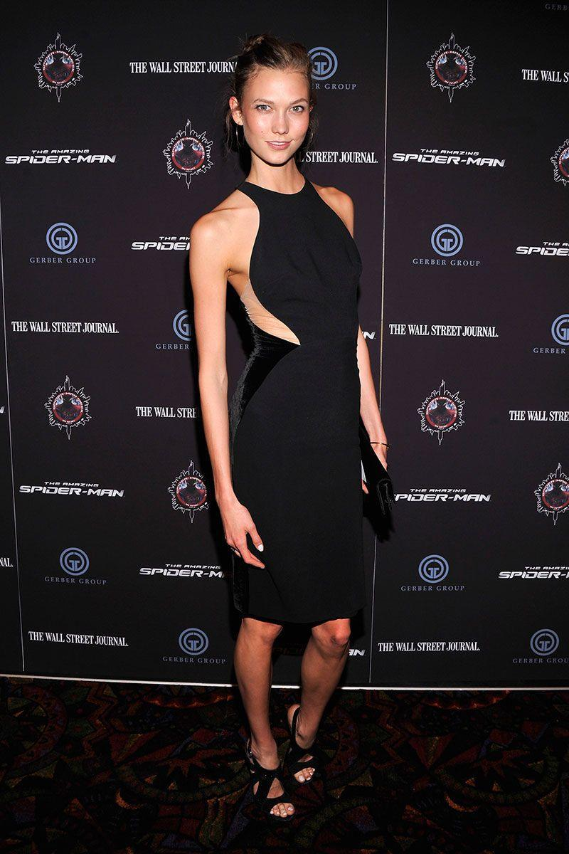 <p>Karlie Kloss's LBD for the <em>The Amazing Spider-Man </em>premiere in New York City included both cutouts, sheer paneling, and a high neck for a modern and edgy look. </p>