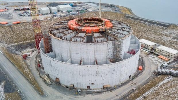 The massive concrete gravity structure for the West White Rose expansion project is more than half complete at a construction site in Argentia, Placentia Bay. The $3.2 billion project was halted last year because of the global pandemic and collapsing oil markets.