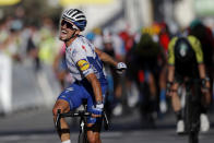 France's Julian Alaphilippe, celebrates as he crosses the finish line to win the second stage of the Tour de France cycling race over 186 kilometers (115,6 miles) with start and finish in Nice, southern France, Sunday, Aug. 30, 2020. Switzerland's Marc Hirschi finished second. (Stephane Mahe/Pool photo via AP)