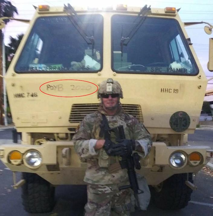 Sgt. Brian Jackson of the California National Guard posted this Facebook photo on June 2 while deployed to police Black Lives Matter protests in Los Angeles. It shows him standing in front of a military vehicle inscribed with a slogan for the Proud Boys, a neo-fascist group. (Photo: Facebook)