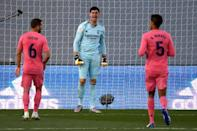 Real Madrid goalkeeper Thibaut Courtois gets his point across but his team slumped to a shock defeat against Cadiz at the weekend