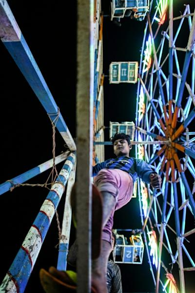 several hundred young men working Myanmar's Ferris wheels -- known as 'char yahat'